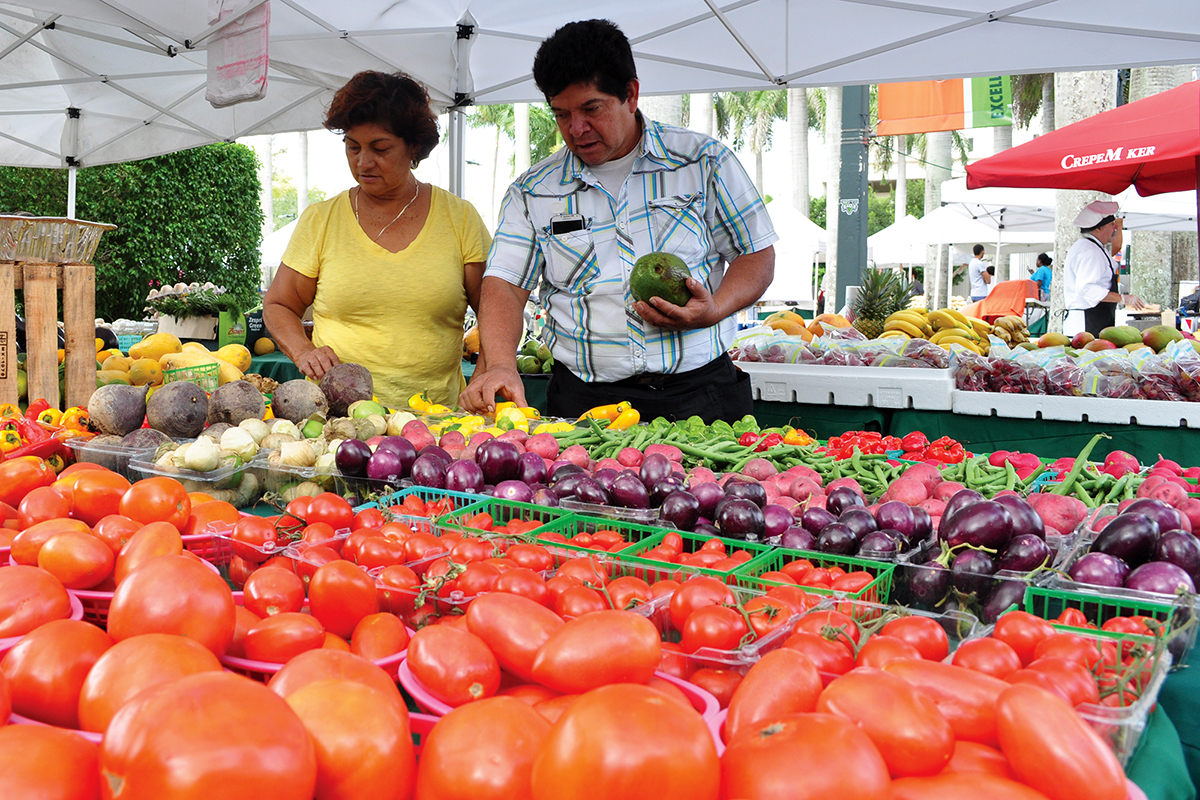 Benita Lara and Johnny Martinez sell fruits and vegetables at the farmer's market on Wednesday morning. Katie Guest // Contributing Photographer