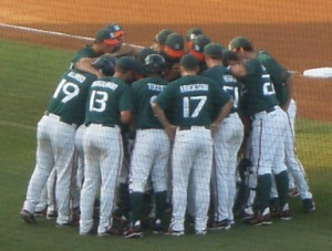 HUDDLE UP: The Miami baseball team gathers together before Sunday\'s deciding game against the Arizona Wildcats. Miami beat Arizona, 4-2, to advance to the College World Series for the twenty-third time in school history. Photo Credit: Christina De Nicola // Hurricane Staff