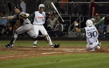 David Villasuso slides in safely for Miami's first run during the second inning of Friday night's 2-1 victory // Jess Hodder