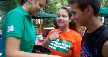 "Freshman Elizabeth Ionescu (center) and Marissa Bell (left) hand out candy to Dylan Dilibrto at the first annual 'Canes Care Scare Fair on the Hecht-Stanford Bridge last Tuesday. ""I was trying to think of a way to go trick-or-treating but this is even better because it's candy and resources,"" said Bell. The fair was aimed at freshman students to help raise awareness of the many resources UM has to offer, such as the Topple Career Center, Wellness Center, Student Government, and Pier 21. Danielle Peloquin//The Miami Hurricane"