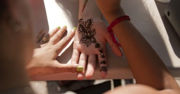 """Saramati Narasimhan, junior, does a henna design for Karen Hernandez, senior, on Wednesday. Narasimhan created her one-woman organization """"Art for a Cause,"""" to do henna, paintings, tattoo designs, graffiti and any other art with all the profits going to charity. Wednesday's event was partnered with the Golden Key honor society and Delta Lambda Phi fraternity with all the proceeds going to St Jude's Children's Hospital, """"It's my one-woman mission to save the world,"""" says Narasimhan, who started the organization after she was diagnosed with chronic pain disorder, """"it's sending out good vibes, art makes people happy and this helps kids get help… why not do this for other kids?"""" Cayla Nimmo//Assistant Photo Editor"""