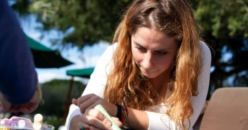 Freshmen Kelsey Flitter doodles with chalk at the U-Doodle table during the Israel at Heart event on the Rock, Wednesday. Israel at Heart was put on by Hillel and I-Team, their mission is to raise awareness of what is going on in Israel and create a dialogue between students about those issues. U-Doodle is a new unofficial club on campus, where they invite people to just come and collaborate to make art by just doodling and create a connected piece of work with the doodles of many. Flitter is a member of I-Team. Cayla Nimmo//Assistant Photo Editor