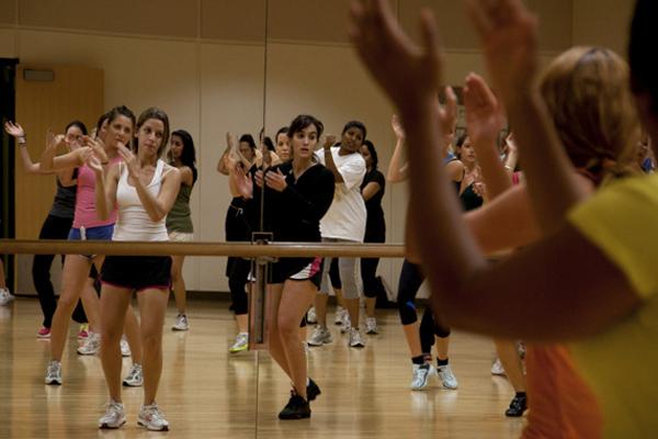 Popular zumba workout mixes dance, muscular toning