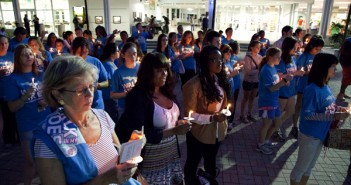 A crowd consisting of community members, representatives from the club No Zebras, and people participating in the walk from Key West to Tallahassee, gathered at the rock on Wednesday night for a vigil celebrating the survivors of sexual abuse. Adrianne D'Angelo//The Miami Hurricane