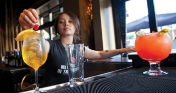 Shelley Urushizaki, a bartender at RA, prepares drinks for happy hour on Wednesday. Natalie Edgar//The Miami Hurricane