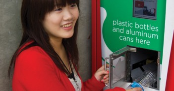 Junior Wistaria Xu recycles a plastic water bottle at the Memorial recycling machine. Vincent Fung//The Miami Hurricane