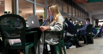 "Jennifer Talarico, freshman, studies for a test while waiting in line for tickets to see Obama outside the bookstore. Talarico arrived in line with her friends around 7:30, and they were already behind 150 others. ""Getting a b on a est is not what I'll remeber,"" says Talarico, ""It's not every day you get to see the president... This is the first year I can vote, so I've been paying attention to process."" The line wrapped around the green and every one who camped out ended up getting a ticket. Cayla Nimmo//Assistant Photo Editor"