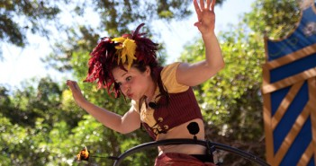 Casey Martin, performer with KamiKaze FireFlies, tries to blow out her flaming hula hoop at the end of one of her tricks at te Florida Renaissance Festival on Sunday. Martin and hr partner, Rob Williams, travel around the United States performing on streets and at festivals. Cayla Nimmo//Assistant Photo Editor