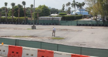 A worker walks through the empty parking lot at the Rosenstiel School of Marine and Atmospheric Science on Virginia Key. Students and professors have to park at The Seaquarium when parking spaces are not available at RSMAS. Monica Herndon//Staff Photographer