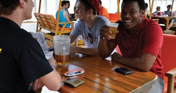 David Shulman, Senior and Advertising Major (left), and Sean Smith, a Marketing Alumni (right), enjoy a pitcher of beer at the Rat. Holly Bensur // Contributing Photographer