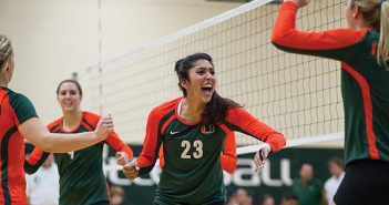 Senior Nrithya Sundararaman celebrates with her teammates after defeating the top ten team, Florida State, in Friday's match. Zach Beeker // The Miami Hurricane