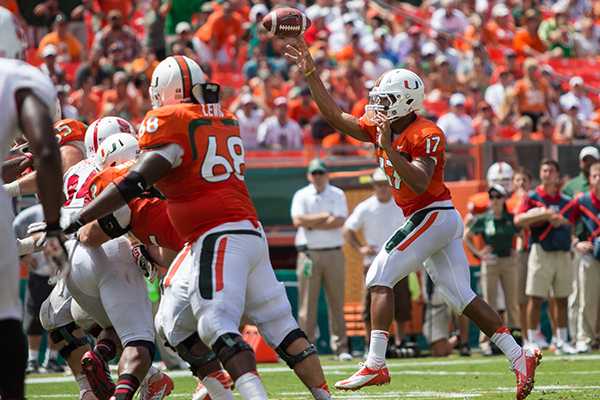 Morris throws for ACC-record 566 yards as Canes outlast Wolfpack