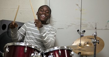 Marc Simplice, 13, performs a drum solo for a song his cassmate wrote on Wednesday evening. Cayla Nimmo // Photo Editor