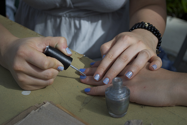Photo Brief: Sigma Pi paints nails for a cause