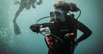 Jacki Coffey keeping an eye on her dive computer during a routine safety stop after diving to three wrecks in 90ft of water off Jupiter, FL.  Participating in the UM Scuba Club dive to witness goliath grouper aggregations during their spawning season is a highlight for many divers during the Fall semester.  This particular dive they saw roughly 80 Goliath Groupers, ranging from 4-6ft in length, as well as loggerhead turtles and reef sharks. Photo Courtesy Patrick Nichols