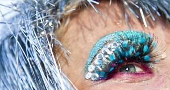 File Photo. A woman dresses from head to toe, detailing her eyes specifically for the 2012 Ultra festival.