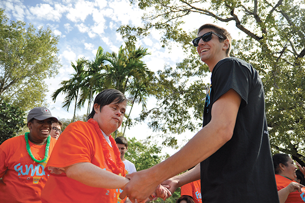 "Sophomore Brian Jozefat Fun Day leader dances with Diane Smith. Sautrday marked the 30th anniversary of Fun Day. The theme was  ""FunDay 2013: 30 Years of Fun in the Sun!"" Over 300 disabled citizens from around Miami were brought to campus. Each person is paired with a college student who volunteer to bring these people around to the different activites. Activities for FunDay 2013 include: a barbeque, arts and crafts, karaoke, a dunk tank, bounce house, DJ, and performances by student groups such as the Hawiian Club. Holly Bensur // Staff Photographer"