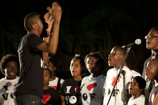 Choir director Gamaliel Fleurantin leads the Voices of Faith Choir from Hillside First Haitian Church of God in a performance for Gospel Explosion. This is the first time the Choir has performed on the University of Miami campus. Charlotte Cushing // Contributing Photographer