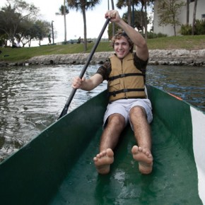 "Senior Matt Kowalski paddles a concrete canoe around Lake Osceola on Wednesday afternoon. Students had the opportunity to row either the concrete canoe or a fiberglass one as part of Engineering Week. Every year, the Engineering school participates in a concrete canoe build for a conference that will take place later this year. The canor Kowalski is paddeling is the one from a competition three years ago. There are two more events for Engineering Week. Thursday, Society of Women Engineers (SWE) are hosting Introduce a Girl to Engineering and Saturday starts a 24-hour ""hackathon,"" UHack, where students must create an app in the allotted time. Cayla Nimmo // Photo Editor"