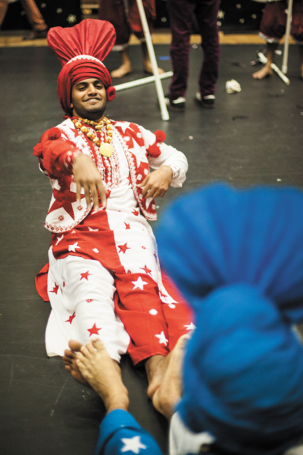 Senior Arjun Anand warms up backstage with his Hurricane Bhangra teammates. Bhangra is an Indian folk dance. The participating UM teams did not compete, but performed as part of the exhibition. Monica Herndon // Assistant Photo Editor