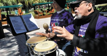 Rosa and Eduardo of the Cuban musical group, Duo Tropical, hit the drums on the rock while students tried a variety of Cuban soft drinks, played games, and learned history. Holly Bensur // Staff Photographer