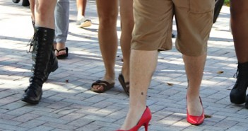 Junior Joe Masterjohn walks in red high heels as a part of Walk a Mile in Her Shoes, an international men's march to end rape, sexual assult and gender violence. The walk took place on the Rock on Friday afternoon. Yinghui Sun // Contributing Photographer