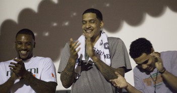 "Junior Erik Swoope, senior Julian Gamble and sophomore Shane Larkin of the Miami men's basketball team laugh onstage during a ""thank you"" ceremony Wednesday night at the Rock.  Monica Herndon // Assistant Photo Editor"