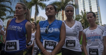 STAYING STRONG: The Brickell Run club hosted a special run in honor of the bombings at the Boston Marathon on Tuesday night. More than 1,000 runners showed their support.