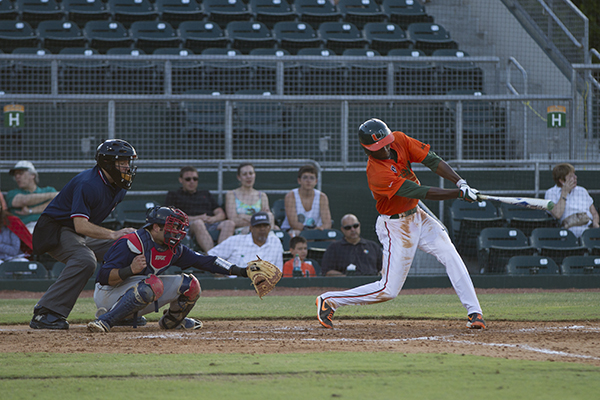 Junior Dale Carey swings during Wednesday night's game against Florida Atlantic University. The Canes won, leaving them with a 11-11 record in the ACC. Nick Gangemi // Staff Photographer