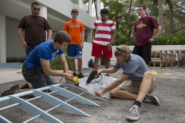 "UM Engineering students work on completing their aircraft on Wednesday afternoon that will take flight at Redbull Flugtag on Saturday. The event, held at Bayfront Park in Downtown Miami, brings together teams that construct homemade aircraft and fly them from an elevated barge into the ocean, aiming to fly the furthest distance. Last year's team won the ""People's Choice Award"" for their Angry Birds themed craft. Vote for this year's team by texting ""MIA15"" to 72855 (voting opens at noon today). Nick Gangemi // Assistant Photo Editor"
