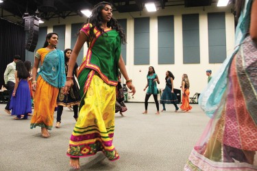 The Fieldhouse at Bank United Center was bursting with Indian tradition Friday night. The UM's Indian Students Association and Hindu Students Council welcomed students to dance Garba, a traditional dance performed around a centrally lit lamp or statue of the Goddess Shakti. Men and women twirled around the room all night long, the spiritual dance is performed in a circle to symbolize the Hindu view of time. The night was colorful as women paraded their most beautiful Sari, Ghagra Choli and Salwars and everyone enjoyed delicious indian cuisine. Michelle Brener // Contributing Photographer