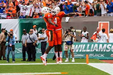 Phillip Dorsett (4) celebrates with Herb Waters (6) after scoring the first touchdown of the game. Nick Gangemi // Assistant Photo Editor