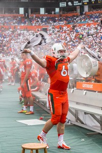 Senior Paul Kelly (61) fires up the crowd during Saturday's game. Nick Gangemi // Assistant Photo Editor