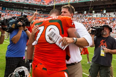 Coach Golden hugs junior Jon Feliciano after the game against UF. Nick Gangemi // Assistant Photo Editor
