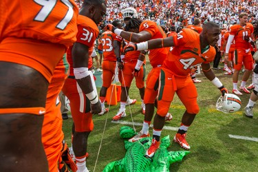 Players celebrate their defeat over the Gators. Nick Gangemi // Assistant Photo Editor