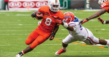 No. 8 Duke Johnson powers past a Gators defender. The Hurricanes defeated the Gators 21-16.  Nick Gangemi // Assistant Photo Editor