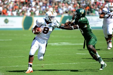 Sophomore Duke Johnson (8) avoids a USF defender during the game Saturday afternoon in Tampa. The Canes won 49 to 21. Photo courtesy Tony Gordon for the USF Oracle.