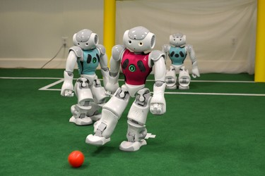 "The robots, created by a team of PhD students at the University of Miami have been programmed to kick a ball by themselves and interact with other ""players,"" simulating a soccer game. Becca Magrino // Contributing Photographer"