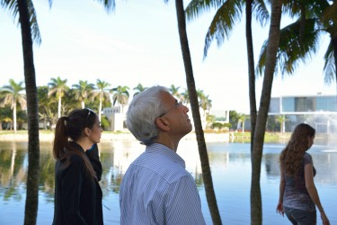 Scott Rogers, the Director of Mindfulness in Law Program, silently walks with University of Miami Law students Jackie Frisch and Stephanie Rosendorf during a meditative walk around the lake early Monday morning. These walks and other similar events are held regularly by the Law school as a way to involve students in activities that can contribute to their overall health and well-being.