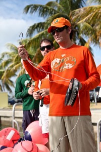 Dr. Neil Hammerschlag explains to UM alumni how to deploy the fishing gear, during a shark tagging trip on November 10th out of key biscayne FL, during alumni weekend. RJD uses a drumline system utilizing a shark friendly circle hook. Photo courtesy Cat Schulz
