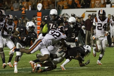 Dallas Crawford (25) gets tacked by the Virginia Tech defense during Saturday's Homecoming game. Nick Gangemi // Assistant Photo Editor