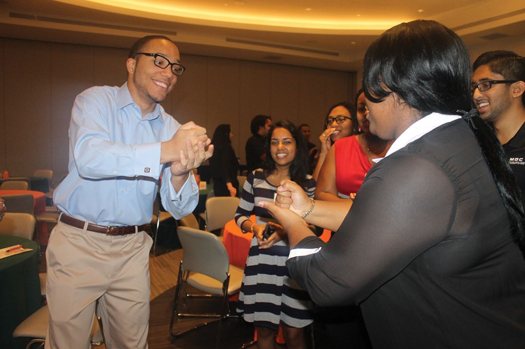 Jackson Bowser, a freshman, and Arlisia Ables, a junior, go fist-to-fist in a game of rock, paper, scissors during 'Canes Lead. The game was used as an icebreaker during the leadership conference, to help students feel more comfortable around each other. Ashley McBride // Contributing Photographer