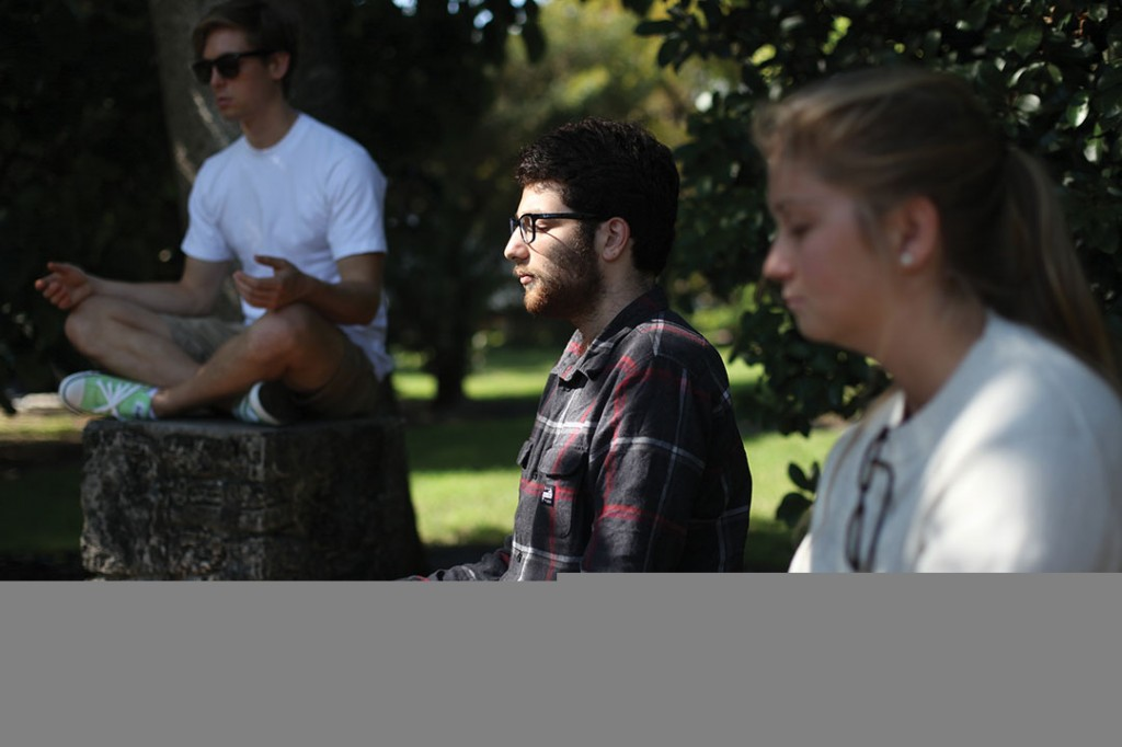 Junior Danny Englert, junior Mason Schechter, and senior Emma Wheeler participate in an SIY shot, with Miami Mindfulness on Friday afternoon in the Arboretum. An SIY shot is a way to infuse the skills and habits from the Search Inside Yourself curriculum into daily life with one or more mental training exercises done in a group of two or more. Monica Herndon // Photo Editor