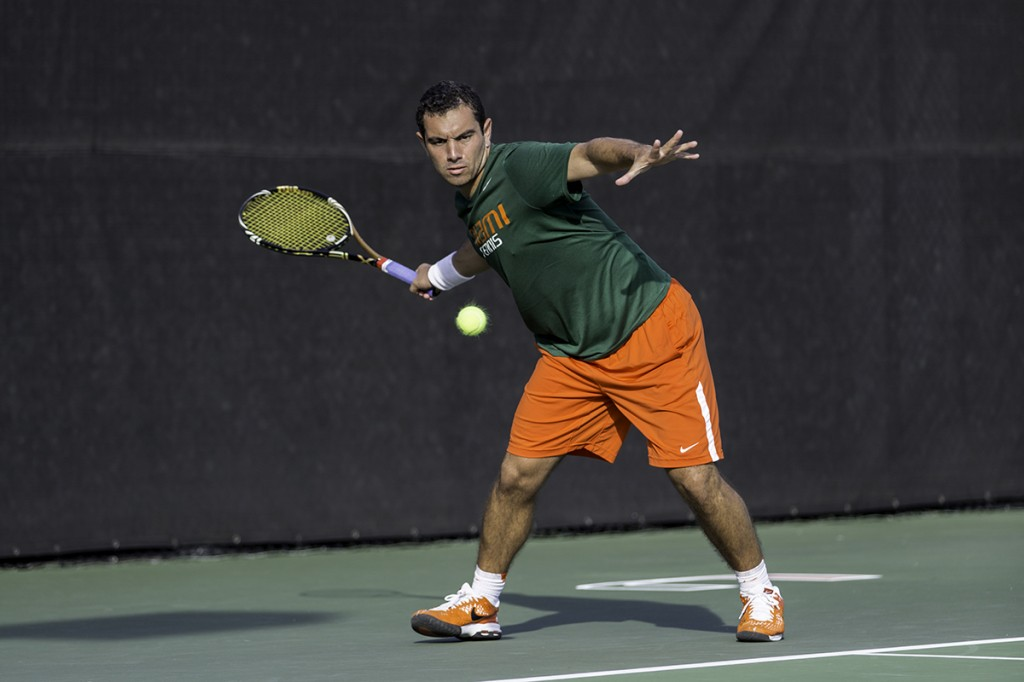 Senior Gabriel Flores prepares to return the ball during the men's tennis match against Florida Atlantic held last Sunday. Nick Gangemi // Assistant Photo Editor