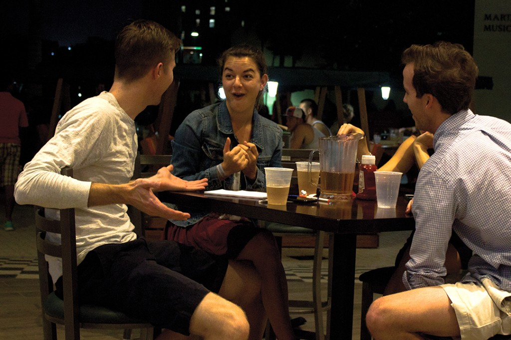 Alumnus Stephen Buckley (left) plays trivia on Tuesday night at the Rat with seniors Talia Touboul and Chris Machatton. Stephanie Lorenzo // Contributing Photographer