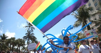 A member of Coral Gables United Church of Chirst walks with members of his congregation down Ocean Drive in South Beach during the 5th annual Pride Parade held in April 2012. File Photo