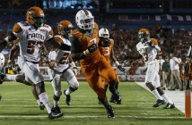 Sophomore Gus Edwards runs past Florida A&M defenders and scores a running touchdown during the second quarter of Saturday night's game. Nick Gangemi // Photo Editor
