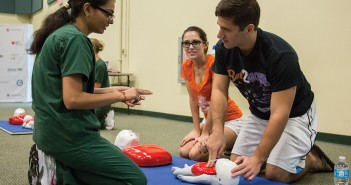 Accelerated BSN Senior Neha Chauhan certifies graduate student Cari Eckman and alum Mike Anderson to preform CPR during Saturday's CPR Day event held at the BUC Fieldhouse. Nick Gangemi // Photo Editor