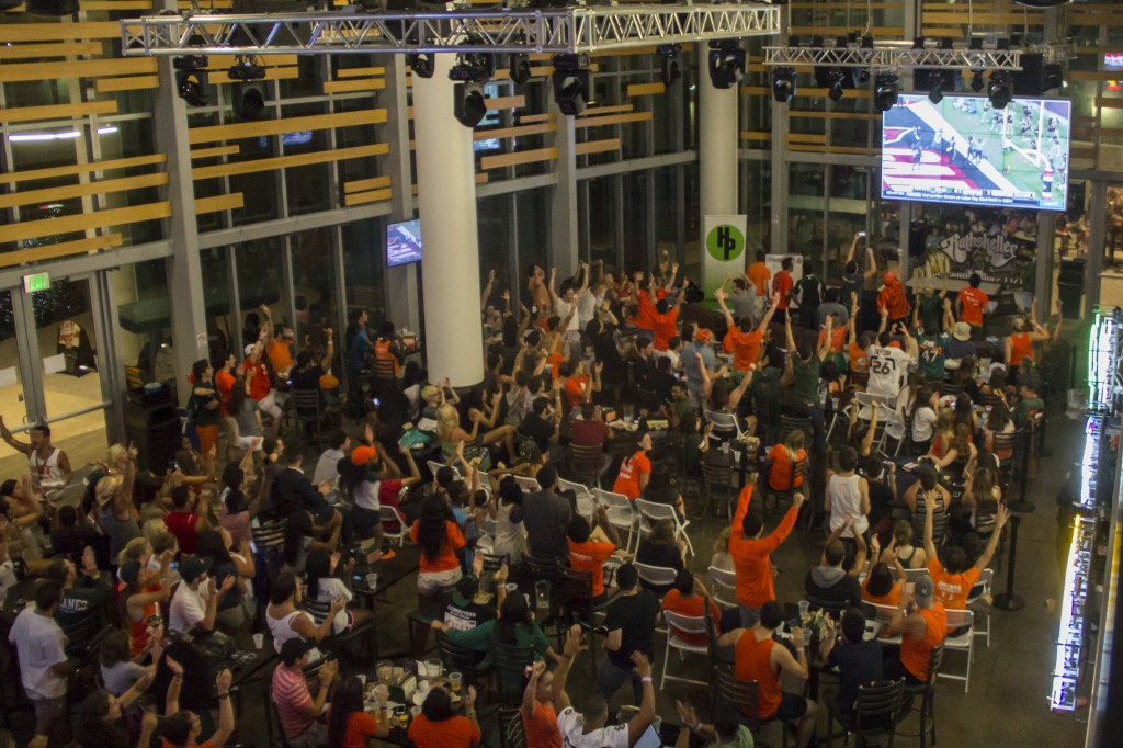 Students celibrate a touchdown during the Rat watch party for the Hurricanes' season opener against Louisville on Saturday. Victoria McKaba // Staff Photographer