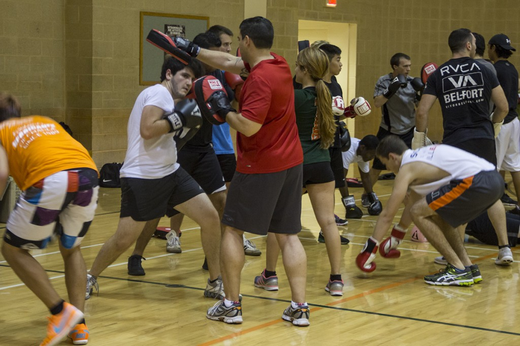 UM boxing club members spar during a practice conducted at Wellness Center on Thursday evening. The boxing club meets at 8 p.m. Tuesdays and Thursdays at the Wellness Center basketball courts.  Victoria McKaba // Staff Photographer